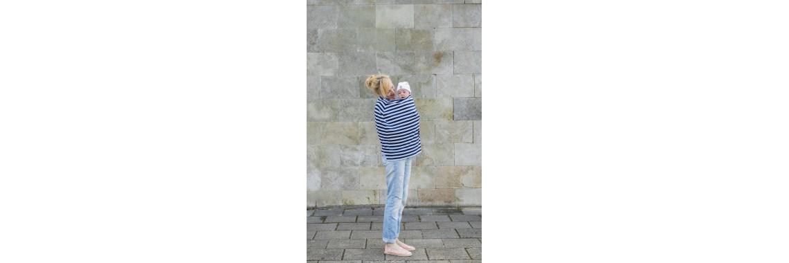 kudikis su skraiste nuo vejo